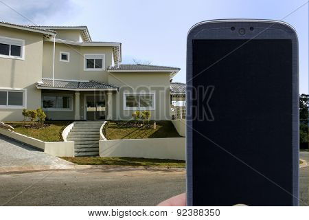 Smatrphone and house. Idea for smartphone home security system, monitoring system, real state applications, contractor, architecture, home improvements,  and others.