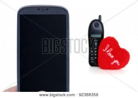 Blue smartphone and blurred telehone with heart. Idea for Valentines Day calls, love, lovers, love apps, Internet, blogs and others.
