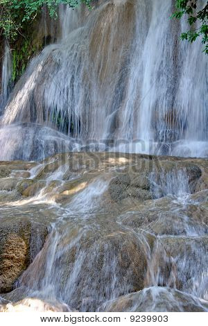 Sai Yok waterfall is a waterfall flowing through all seasons throughout the year. poster