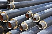 Steel pipe with heat insulation on construction site poster