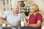 Helper Serving Senior Man With Meal In Care Home poster