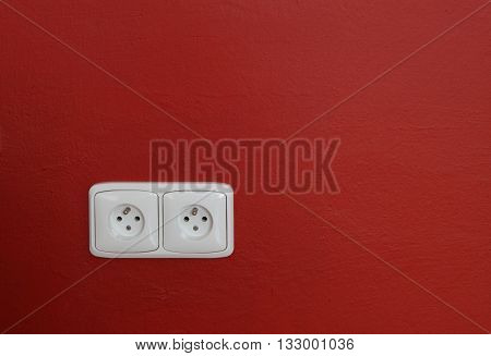 white wall outlets on the red wall