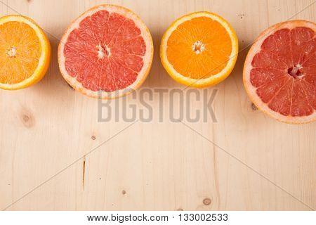 Horizontal Half Cut Orange, Grapefruit Flat Lay On Wooden Background