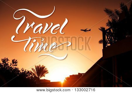 silhouette airplane above tropical resort in Egypt and words Travel time.