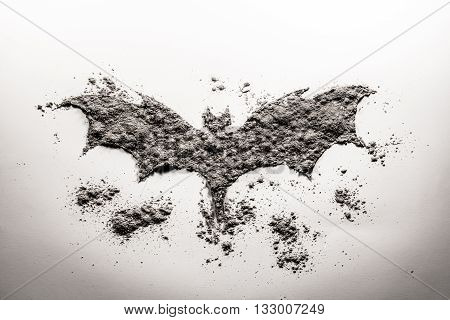 Vampire bat dracula silhouette shadow symbol drawing in dust ash sand