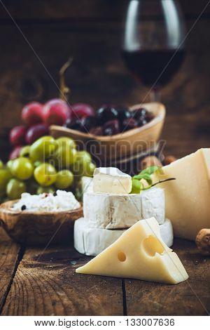 Cheese variety.Food background. Fresh ingredients on wood