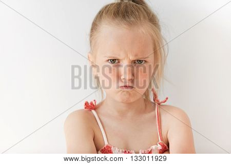 Close Up Portrait Of Disobedient Child Demanding Attention. Little Caucasian Girl Feeling Aggravated
