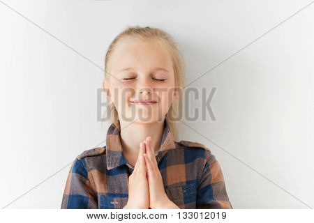 Pretty Little Girl With Closed Eyes Smiling And Meditating With Happy Face In Morning Light. Blond C