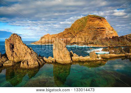 natural swimming pools of volcanic lava in Porto Moniz Madeira island Portugal poster