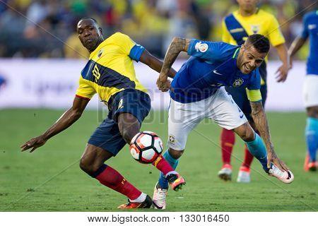 PASADENA, CA - JUNE 4: Walter Ayovi (L) & Dani Alves during the COPA America game between Brazil & Ecuador on June 4th 2016 at the Rose Bowl in Pasadena, Ca.