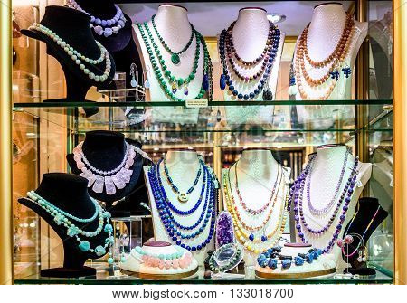 Display With Different Designs Of Handmade Jewelry On Stand.