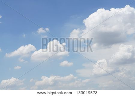 White clouds, in the blue sky, is forming as a rain clouds (thunderstorm clouds; Cumulonimbus clouds).