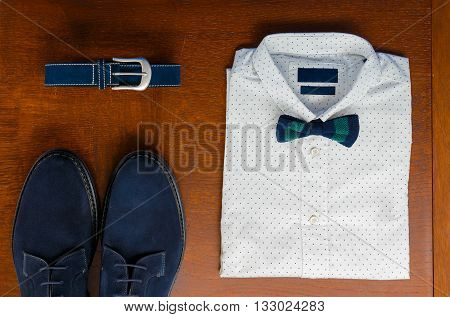 Mens Outfits, White Polka-dot Shirt With With Bow Tie, Blue Belt And Shoes On Brown Background. Mens