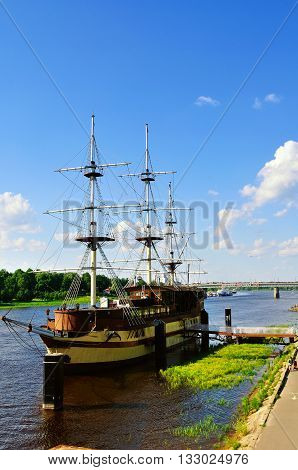 VELIKY NOVGOROD RUSSIA -JUNE 32016. Summer cityscape with restaurant Frigate Flagship at the Volkhov river at summer sunset