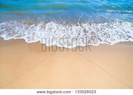 Summer concept background - Sea or Ocean Beach with gentle surf of wave and sand