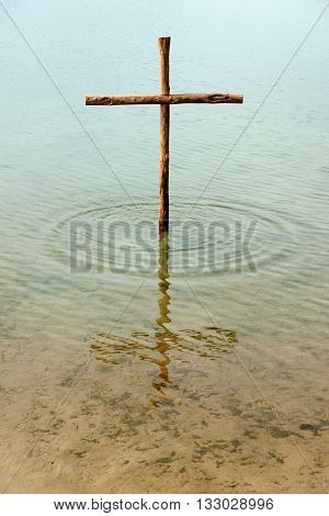 Wooden Cross In The Water