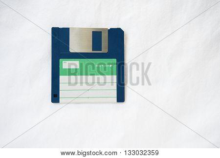 retro dark blue diskette on white backgrpund