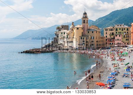 CAMOGLI, ITALY - JUNE 5 2016: Crowd in the beach of Camogli near Genoa during a sunny sunday afternoon