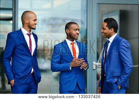 Successful, happy, lucky, handsome, smiling, stylish, foreign, sexy businessmen, business team group, businessmen discussing new projects, important meeting, conference. Happy African, Uzbek students on practice.