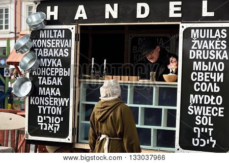VILNIUS LITHUANIA - MARCH 6: Unidentified people sell Jewish souvenirs in annual traditional crafts fair - Kaziuko fair on March 6 2016 in Vilnius Lithuania