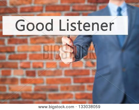 Good Listener - Businessman Hand Holding Sign