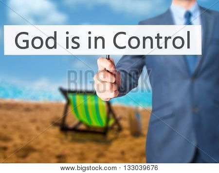 God Is In Control - Businessman Hand Holding Sign