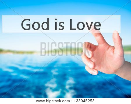 God Is Love - Hand Pressing A Button On Blurred Background Concept On Visual Screen.