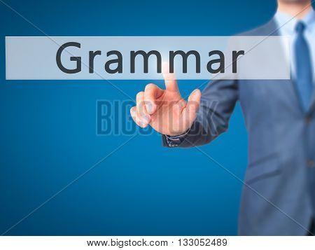 Grammar - Businessman Hand Pressing Button On Touch Screen Interface.