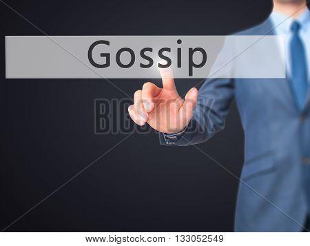 Gossip - Businessman Hand Pressing Button On Touch Screen Interface.