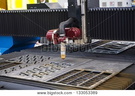 Machine for constant metal laser cutting, metal processing close up