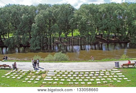 Yekaterinburg Russia - July 20 2015: people are walking nearly monument of computer keyboard in park of Yekaterinburg Russia
