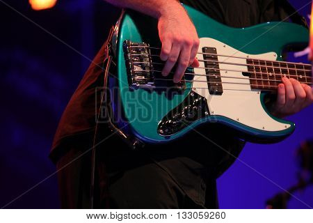 bass player play a rock gig on the stage