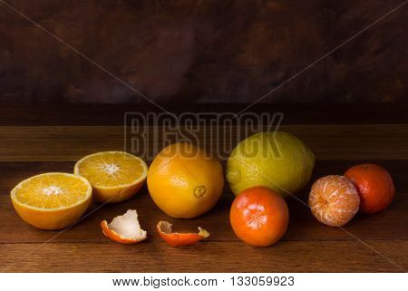 Still life with oranges and lemons isolated on wood