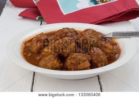 Meatballs with tomato marinara sauce on white