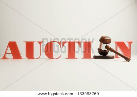 3d Wooden auction gavel on light background, close up