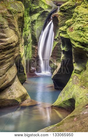 Secluded Robinson Falls also know as Corkscrew Falls flows in the Hocking Hills of Ohio.