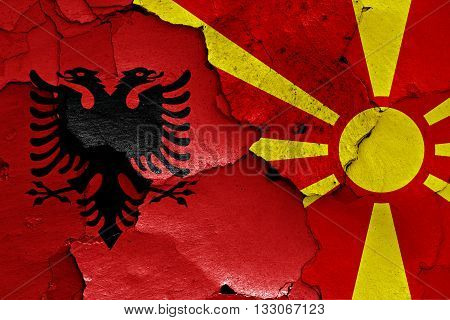 Flags Of Albania And Macedonia Painted On Cracked Wall