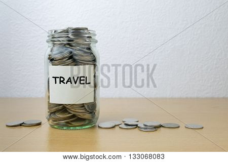 Money saving for travel in the glass bottle