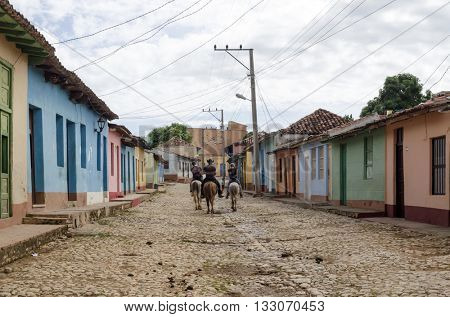 TRINIDAD - DECEMBER 3: Residents and tourists on the old colorful street on 3 December 2015 in Trinidad, Cuba. City of Trinidad is a UNESCO World Heritage Site