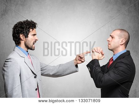 Boss firing a supplicating employee