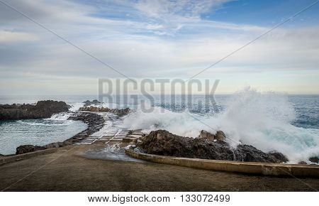 Waves splashing of pier to the Atlantic ocean in Seixal. North coast of Madeira island, Portugal.