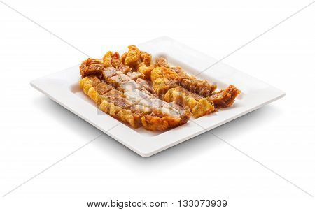 Crispy Pork Slice On Dish Isolated On White Background