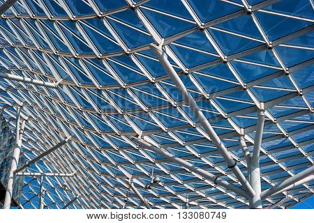 Milan Italy - May 25 2016: The glass roof of the exhibition center Fiera Milano Rho. The roof has a bend and is based on the column.