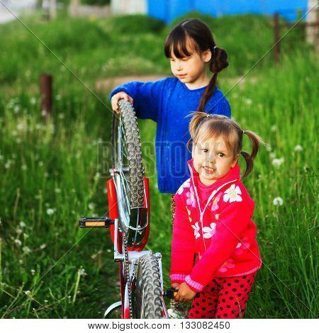 Children Repair Bicycle.