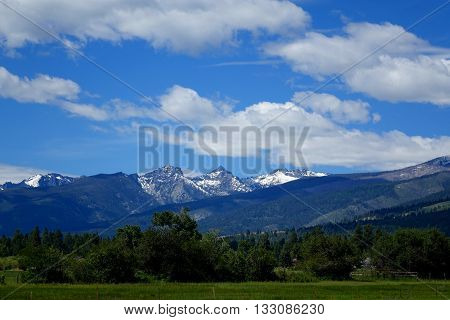 The Bitterroot Mountains provide a beautiful background to farms and ranches in Montana.