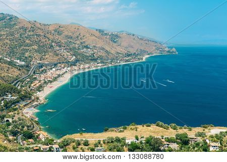 view of the beautiful coastline near the town of Taormina, Sicily, Italy. Painting of vintage photo