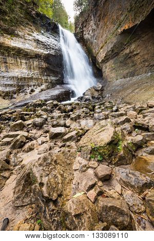 Miners Falls at Pictured Rocks National Lakeshore in the Upper Peninsula of Michigan. Jumbled rocks create the creekbed for Miners River