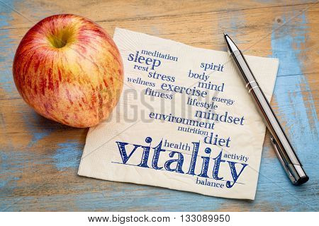 vitality and vital energy word cloud - handwriting on a napkin with a fresh apple