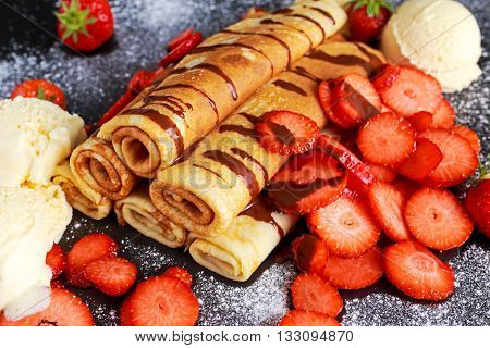 Sweet Rolled Pancakes with nutella, strawberry and ice cream.