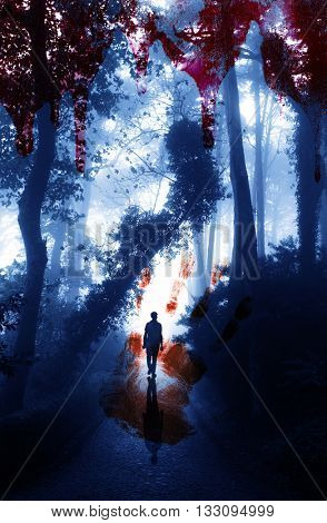 Halloween background. Bloody hand print and blood streaks on the background of the misty forest with men